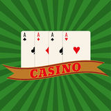 Four aces on a radiant background Stock Images