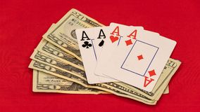 Four aces with a stack of twenty dollar bills. royalty free stock images