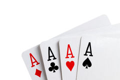 Four aces standing. On white background stock photography