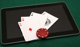Four aces on tablet. Four (4) aces on tablet with red chip on them. Really good hand to win royalty free stock image