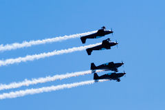 Four acrobatic planes fly close mirror formation Royalty Free Stock Image