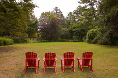 Four Adirondike Chairs Landscape Stock Photo