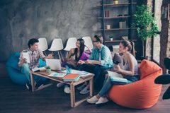 Four adorable smart, clever people, friends, beautiful nice attr royalty free stock photo