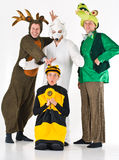 Four adults in costume. A studio view of a group of four happy adults in various animal costumes Royalty Free Stock Photo