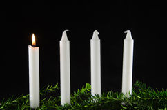 Four advent candles at black background Stock Images