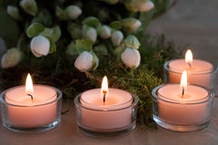 Four Advent candles. Closeup of four burning Advent candles studio shot Royalty Free Stock Images