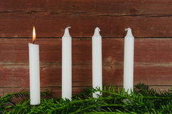 Four advent candles at an old plank wall Royalty Free Stock Photos