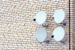 Four aerials of satellite television. Royalty Free Stock Image