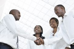 Four african business partners shake hands Stock Photo