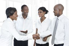 Four african business partners shake hands Royalty Free Stock Images