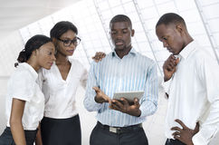 Four african business people with tablet PC Royalty Free Stock Image