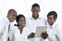 Four african business people with tablet PC Royalty Free Stock Photography