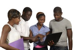 Four african friends looking at tablet PC. Studio Shot Royalty Free Stock Photography