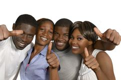 Four african friends showing thumbs up Royalty Free Stock Photos