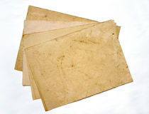 Four aged sheets of paper. Lying one on another Royalty Free Stock Image