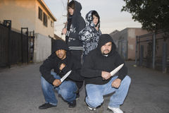 Four Aggressive Robbers Holding Knives Royalty Free Stock Images