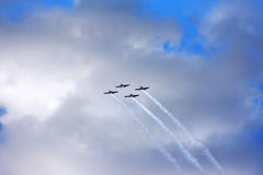 Four airplanes fly in the sky Stock Photos