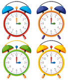 Four alarm clocks with different time Royalty Free Stock Photo