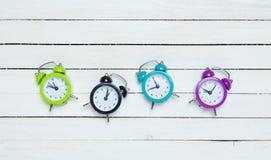 Four alarm clocks. On white background stock photo