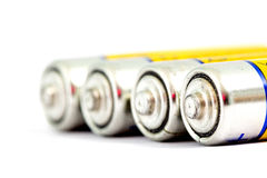 Four alkaline batteries AA size with shallow dof Royalty Free Stock Photos