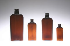 Four Amber Bottles Royalty Free Stock Images
