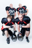 Four American football players. Isolated on white background Royalty Free Stock Photography