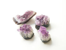 Four Amethyst geodes for crystal therapy treatments and reiki Stock Photo