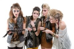 Four amused friends. Four native amused friends with interesting hairstyles stock images