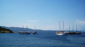 Anchored ships. Four anchored touristic, sailing cruise ships at bay near island Krk Stock Images