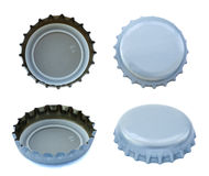 Isolated Silver Metal Caps. Four angles of silver colored metal caps, used for glass soda bottles Stock Image