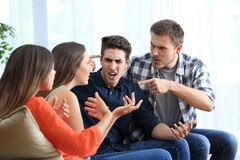 Four angry friends arguing at home royalty free stock photography