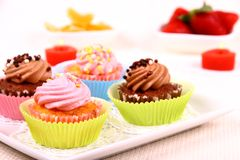 Four appetizing cupcakes on white plate Royalty Free Stock Photo