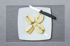 Four apple pieces. On a plate Stock Photos