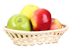 Four apples in basket Royalty Free Stock Image