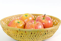Four apples in a basket Royalty Free Stock Photography