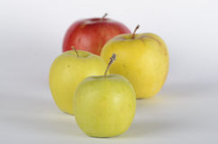 Four apples. Green and red apples on white background Royalty Free Stock Photography