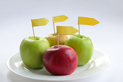 Four apples with label Royalty Free Stock Photos
