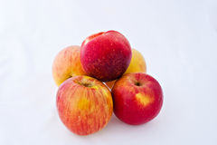 Four apples and a nectarine Royalty Free Stock Photos