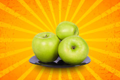 Four apples on a plate Royalty Free Stock Photo