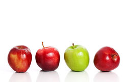 Four apples in a row Royalty Free Stock Photography