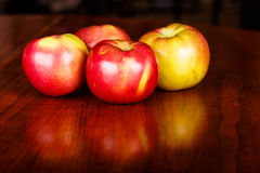Four Apples on Wood Table Royalty Free Stock Photo