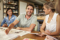 Four Architects Sitting Around Table Having Meeting Stock Photos