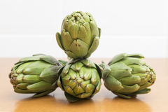 Four artichokes in a dynamic assembly Stock Photography