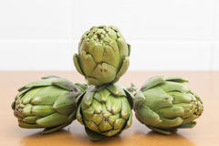 Four artichokes forming a dynamic set Royalty Free Stock Images