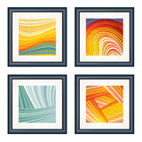 Four Artworks. Modern Artworks in black frames on the white wall Royalty Free Stock Photography