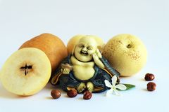 Four asians pears with smiling Buddha royalty free stock photos