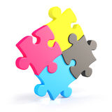 Four assembling colorful puzzle pieces in cmyk Stock Photo