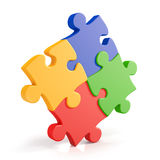 Four assembling colorful puzzle pieces Royalty Free Stock Image