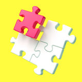 Four assembling puzzle pieces on yellow background Royalty Free Stock Photos
