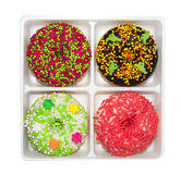 Four assorted doughnuts Royalty Free Stock Photos